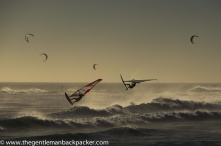 """""""A Day at Bloubergstrand"""": Windsurfers and kite surfers enjoy the choppy seas at Bloubergstrand, Cape Town, South Africa, which is rebranding itself as a world-renowned sport-tourism destination in the post-Apartheid era, capped by the World Cup hosted in 2010. April, 2010."""