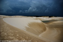 """""""Creation of Life"""": A storm rolls in over the sand dunes of Lencois Maranhenses, Brazil. The rainy season creates temporary fresh water lagoons and locals farm fish in them in order to survive."""