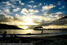 """""""The Land of Hanalei"""": People enjoy the sunset in this land made famous by """"Puff the Magic Dragon,"""" on their boats, on the pier, in the water, and on the sand. Kauai, April 2013."""